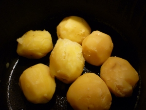 I peel and then boil the potatoes, but as long as they're cooked it shouldn't matter how it's accomplished.  The potatoes work best if they're cooled.3 pounds cooked potatoes, peeled