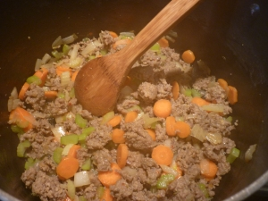 Fry 1 lb Italian sausage, 1 chopped onion, 3 chopped celery stalks, 3 chopped carrots, 1 Tbsp. lemon peel in a large pan until the sausage is cooked through.