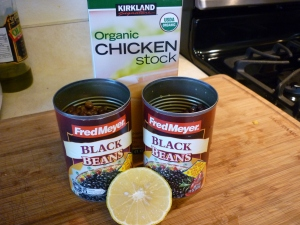Stir in 1 quart (or liter) of chicken broth, 2 15-oz. cans black beans, drained, and 2 Tbsp lemon juice. Simmer for 45 minutes. Serve.