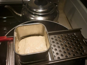 Working in batches, press a batch of batter through the device (spaetzle maker or flat cheese grater or dripping it off a spoon) into the boiling waterThe batter is supposed to drip into the pot and cook in the water.