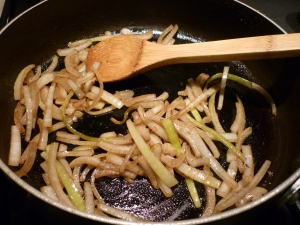 Using the same skillet, brown sliced onions. Add to mushrooms and set aside.