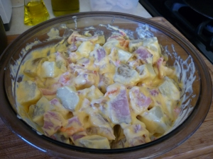 Remove from heat and stir into potatoes and ham. Stir in 4 ounces of sliced pimiento.