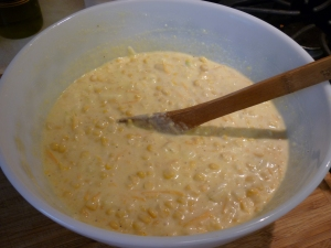 Stir in 2/3 cup milk, 3 tablespoons melted butter, 1 beaten egg, 1 tablespoon sugar, 1/2 cup shredded cheddar, and salt and pepper.