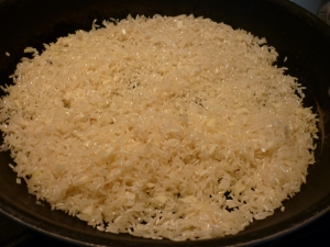 Heat 2 Tbsp. olive oil in large skillet. Stir in 3 cloves garlic, crushed; ½ tsp. dried red pepper flakes; and 2 cups short-grain white rice (I always use Jasmine rice). Cook, stirring, to coat rice with oil, about 3 minutes.