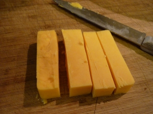 "Cut a 4x2x2"" block of cheese (any kind will do, I would imagine) into 4"" rectangles."