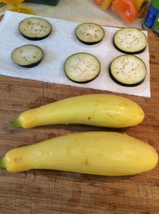 "Slice summer squash (yellow obviously is what I used, but zucchini would work just the same) into ¼"" slices crosswise. I had a bag of sweet mini-peppers from Costco and I used what was left of those, a dozen should do it. I was a little shy on the peppers, but it turned out fine. I cut the tops off and made sure there weren't any seeds, then sliced each pepper in half lengthwise."