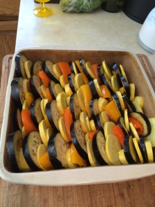 I started with the peppers upright, but when I realized I'd be short at the end, I turned the remaining ones sideways. I filled in some of the gaps with the smaller slices of squash. Sprinkle the top with olive oil, salt, pepper, and sliced fresh basil.
