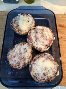 Fill each mushroom cap with the sausage filling. Sprinkle the tops with Parmesan cheese.