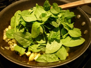 Stir in a couple large handfuls of baby spinach.