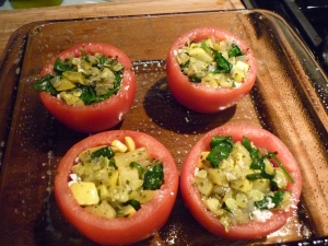 Sprinkle feta crumbles into the bottom of each tomato, then add a layer of filling, more crumbles, and then more filling.