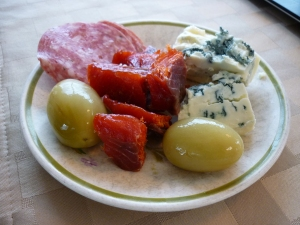 Those aren't grapes, they're green tomato pickles, along with smoked salmon, bleu cheese, and Italian dry salame. What a great snack!