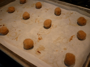 Place dough balls, well-spaced, on greased (or parchment-lined) baking sheet. [My parchment paper was used to make Berlinerkranzer just before making these.]