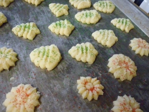 Fill cookie press with dough; form desired shapes on ungreased baking sheet. Sprinkle lightly with colored sugar.